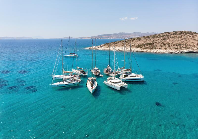 Polyaigos, Cyclades / Greece: 14 May 2018: Sailing boats in star formation. Polyaigos is the largest uninhabited island of the stock photography