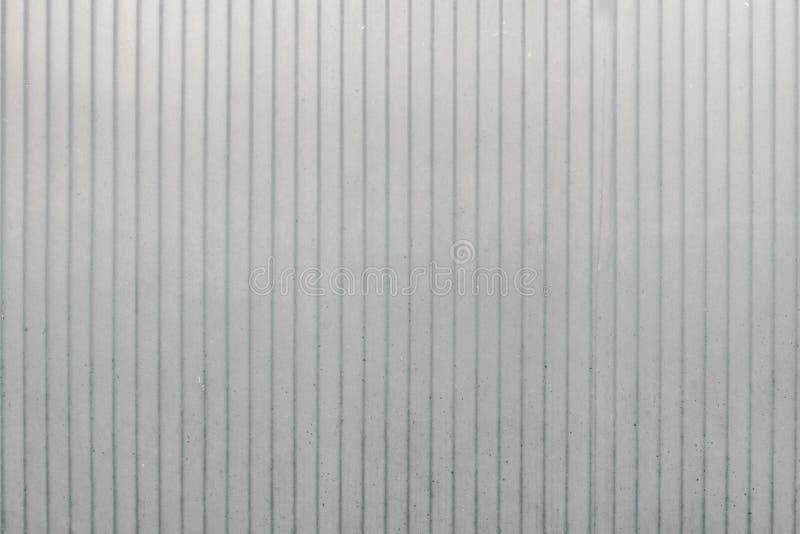 polycarbonate Textura color de Bruno que él frotó debido al sun' rayos de s tiene una sombra mate hay polvo y suciedad imágenes de archivo libres de regalías