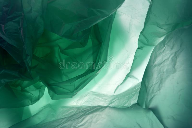 Polyethylene may use as background. Template for card, poster, banner design. Dark green background. Space for your. Plastic bag. Polyethylene may use as stock photo