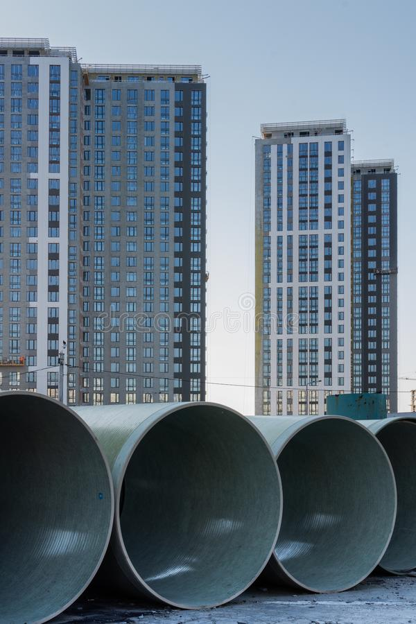 Polyethylene pipes for underground pipeline. Construction of high-rise skyscrapers stock image