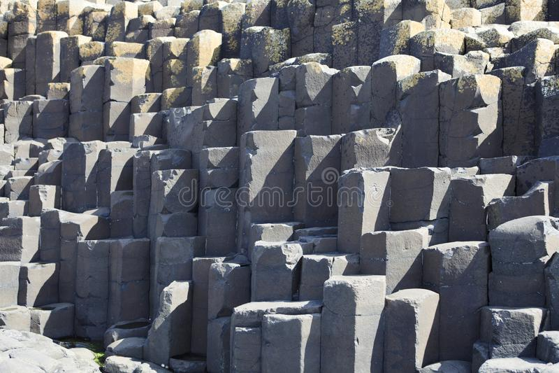 Polygonal basalt lava rock columns of the Giant`s Causeway. Ulster Ireland, - July 20, 2016: Polygonal basalt lava rock columns of the Giant`s Causeway on the royalty free stock photos