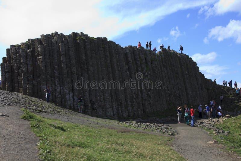 Polygonal basalt lava rock columns of the Giant`s Causeway. Ulster Ireland, - July 20, 2016: Polygonal basalt lava rock columns of the Giant`s Causeway on the royalty free stock photo