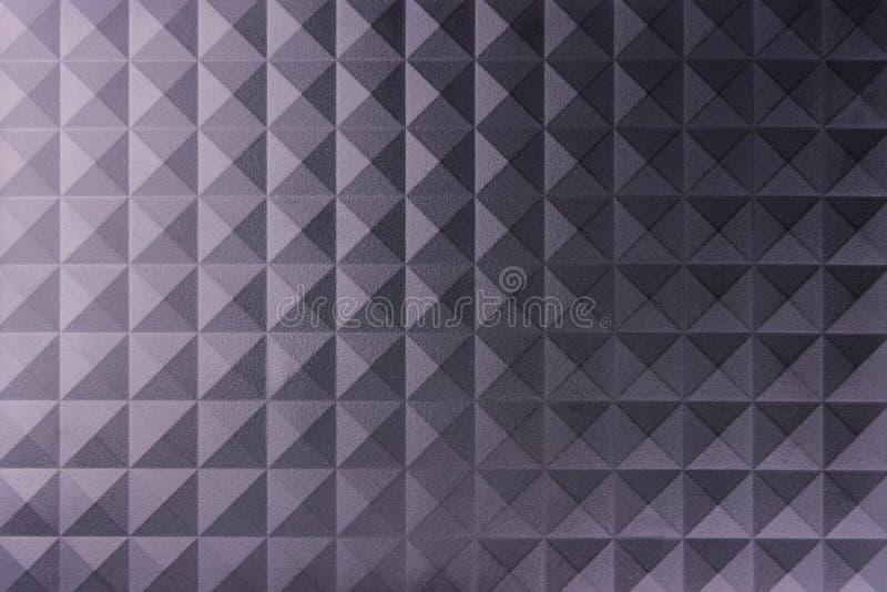 Polygonal svartvit skinande metallbakgrund royaltyfria foton