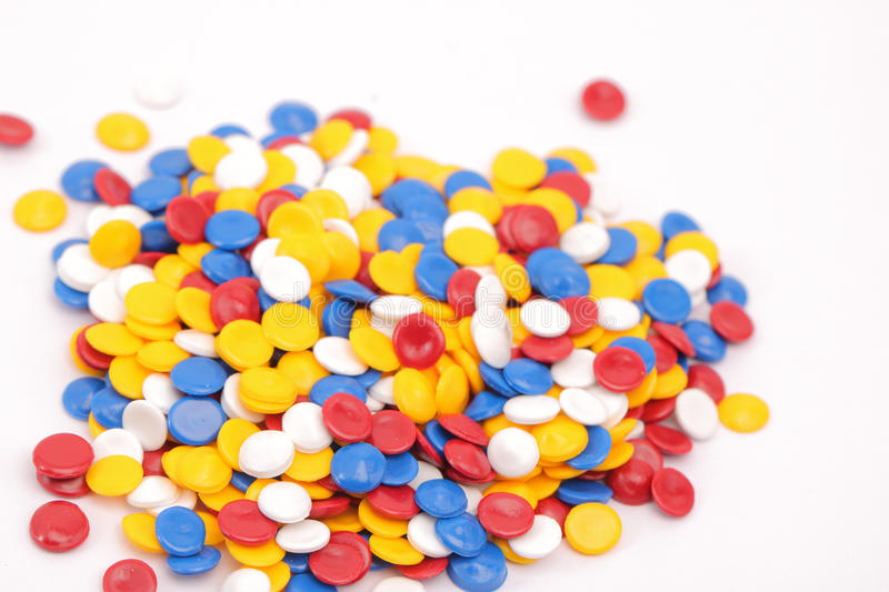 Polymer. Colorful plastic polymer granules on white stock images