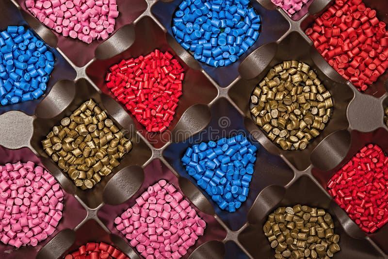 Polymeric dye. Colorant for plastics. Pigment in the granules. Polymeric dye. Plastic pellets. Colorant for plastics. Pigment in the granules stock images