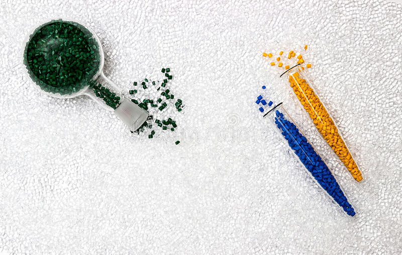 Polymeric dye. Colorant for plastics. Pigment in the granules. Polymeric dye. Plastic pellets. Colorant for plastics. Pigment in the granules royalty free stock photos