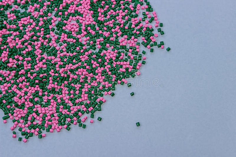 Polymeric dye. Plastic pellets. Colorant for the granules. Polymer beads. Polymeric dye. Plastic pellets. Colorant for plastics. Pigment in the granules. Polymer stock image