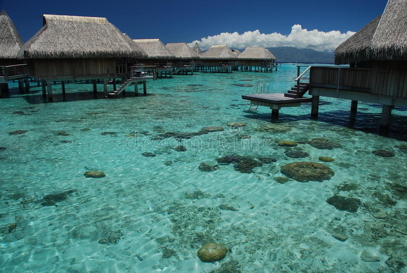 Polynesian overwater bungalows. Moorea, French Polynesia. Moorea is a high island in French Polynesia, part of the Society Islands, 17 km northwest of Tahiti royalty free stock photos