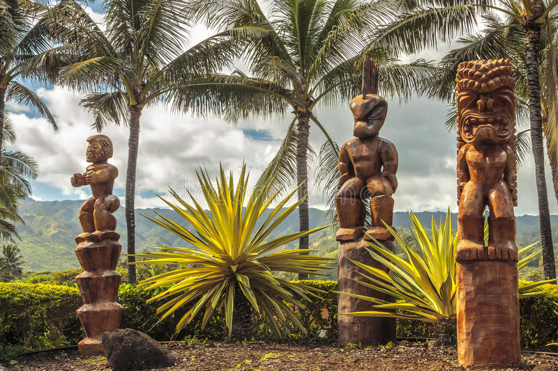 Polynesian Tiki. Three wooden Polynesian tiki carvings on Oahu, Hawaii stock photos