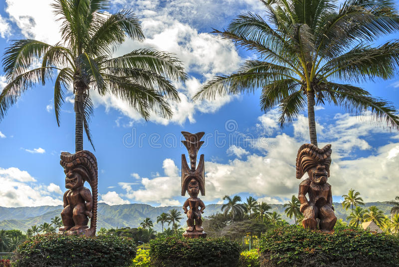 Polynesian Tiki. Three wooden Polynesian tiki carvings on Oahu, Hawaii royalty free stock images