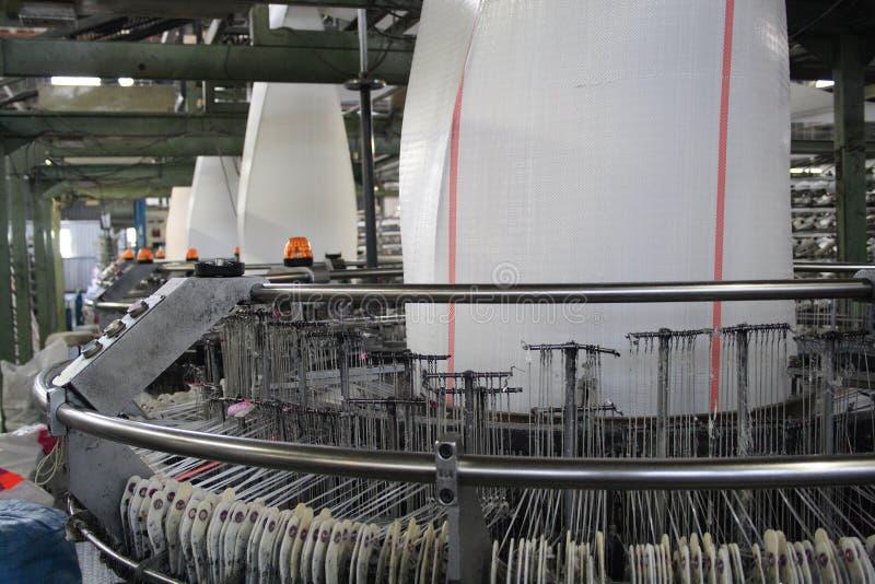 Polypropylene cloth loom. A few polypropylene cloth looms stock photography