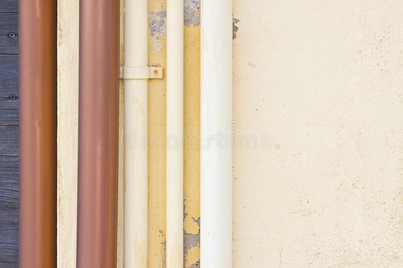 Polypropylene pipes for water against a plaster wall - image with copy space.  stock photography