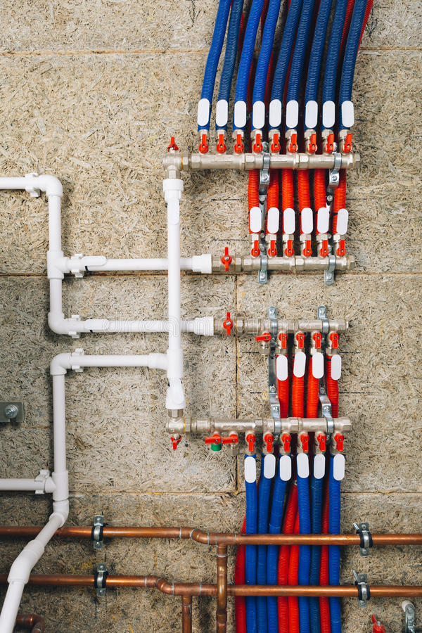 Polypropylene plastic pipes with ball valves in boiler room. Closeup view stock photo