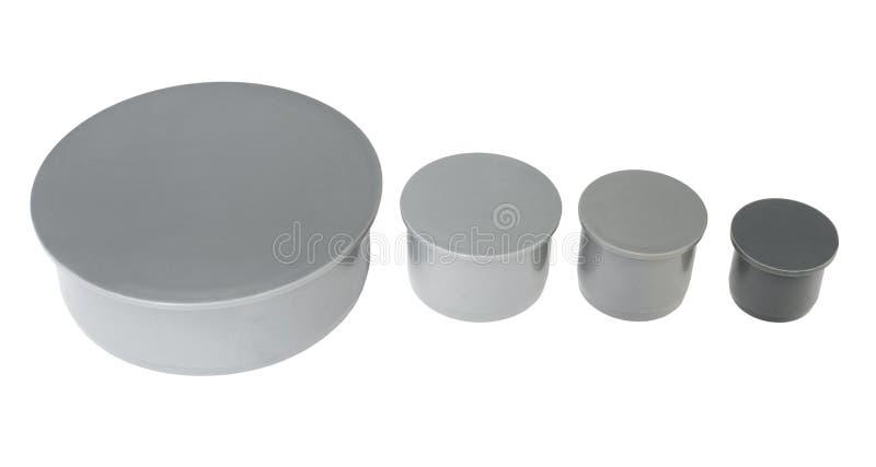 Polypropylene plug fittings. Four polypropylene plug fittings of different caliber royalty free stock photo