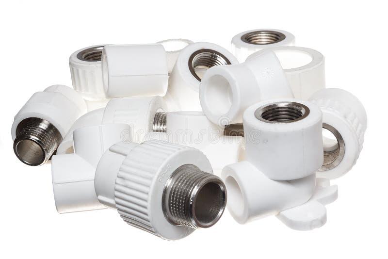 Polypropylene (PVC) fittings on white background. Polypropylene (PVC) fittings for plumbing and sanitary system stock photo