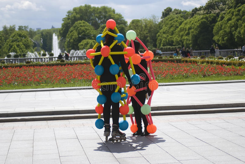 Polytech Festival in Gorky park, Moscow. Actors pose for photos. MOSCOW - MAY 25, 2017: Actors dressed in black costumes decorated by colorful red, orange, blue stock photos