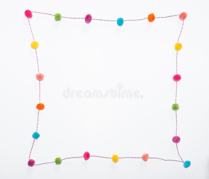 Pom Poms in a Curvilinear Square against a white background. stock image