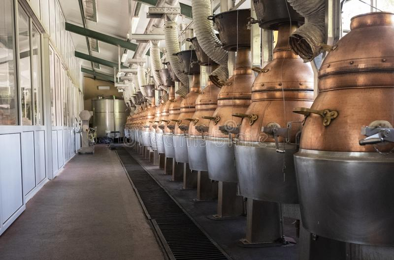 Pomace factory with different machinery for use, copper-colored stills stock photo
