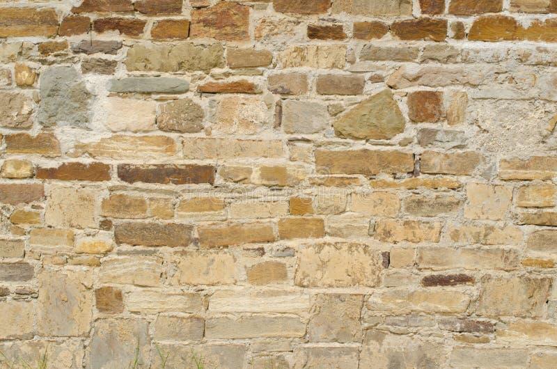 Pomarańcze ściana dziki kamienia zakończenie up zdjęcie stock
