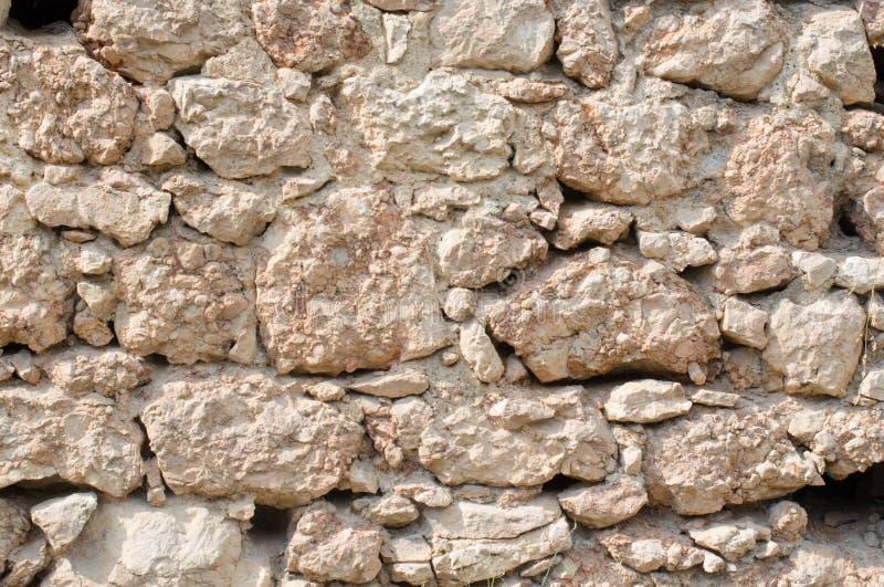 Pomarańcze ściana dziki kamienia zakończenie up obraz stock