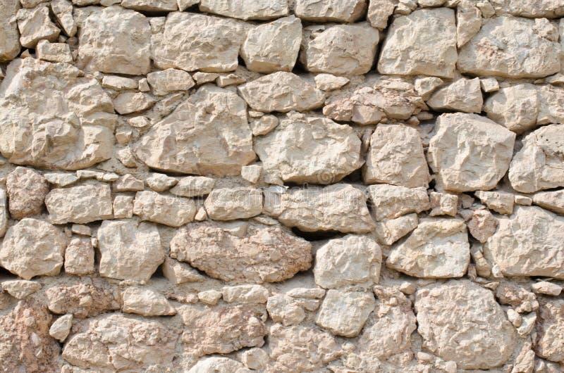Pomarańcze ściana dziki kamienia zakończenie up fotografia royalty free
