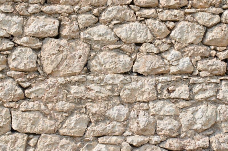Pomarańcze ściana dziki kamienia zakończenie up zdjęcia stock