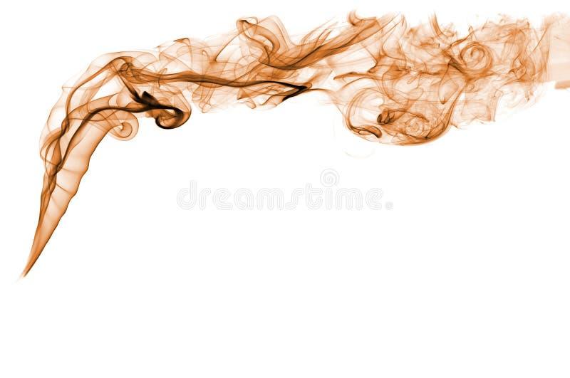 Pomarańcze barwiący dym w białym tle obrazy royalty free