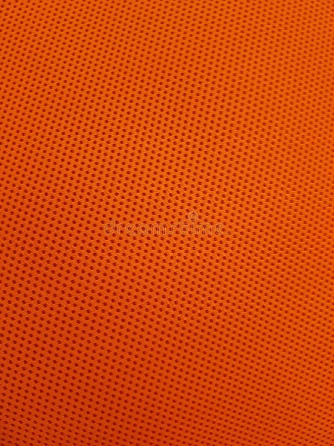 Pomarańcze Dziurkujący Deseniowy tkaniny tło obrazy royalty free