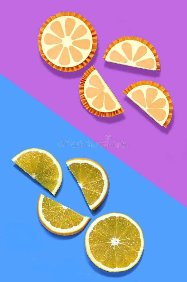 Pomarańcze i ich papierowi modele obrazy stock