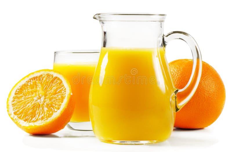 Pomarańcze i sok pomarańczowy obraz royalty free
