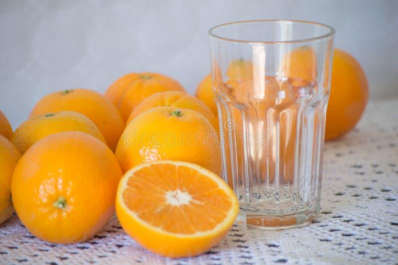 Pomarańcze i szkło obrazy royalty free