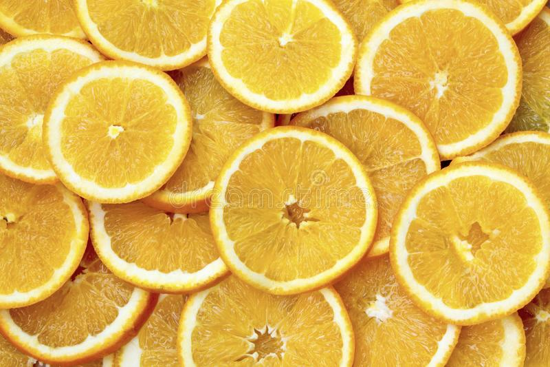 Pomarańcze owoc tło Pomarańcze plasterki Zdrowy foo zdjęcie stock