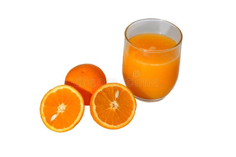 Pomarańcze rozszczepia w połówce z szkłem sok pomarańczowy zdjęcia royalty free