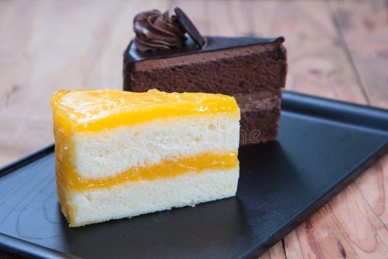Pomarańcze tortowy & czekoladowy tort obraz royalty free