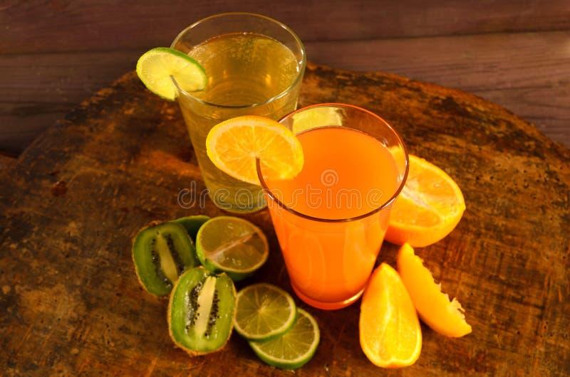 Pomarańcze, wapna i kiwi sok, obrazy royalty free