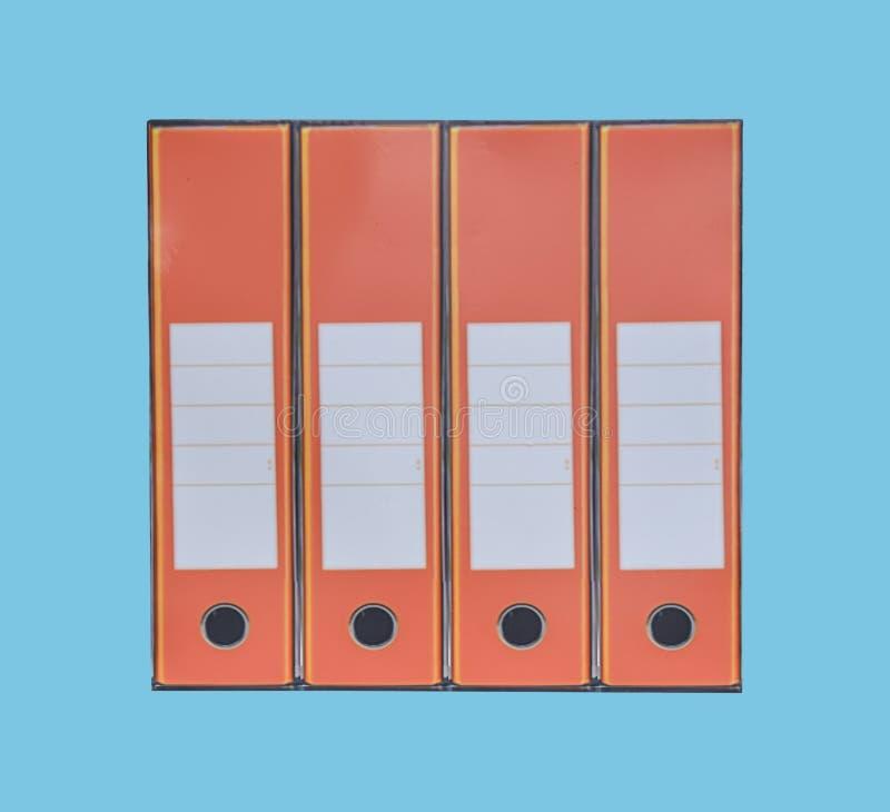 Pomarańczowa księgowości administracji falcówka i papierkowa robota na błękicie fotografia royalty free