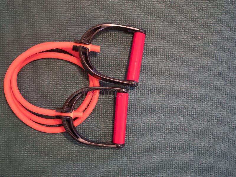 Pomarańczowa opór tubka z czerni, rewolucjonistki rękojeściami/ zdjęcia stock