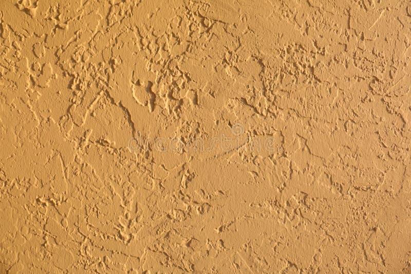 Pomarańczowa stiuk ściany tła tekstura obrazy royalty free