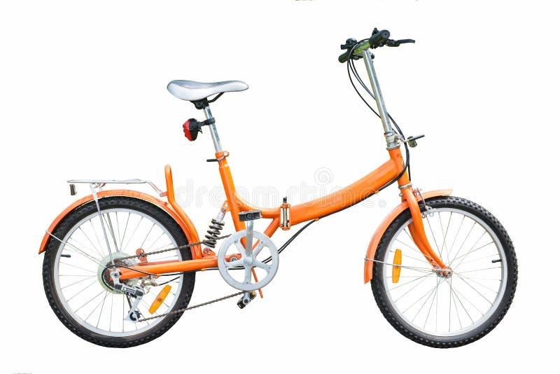 Pomarańczowi falcowanie bicykle na białym tle zdjęcie stock