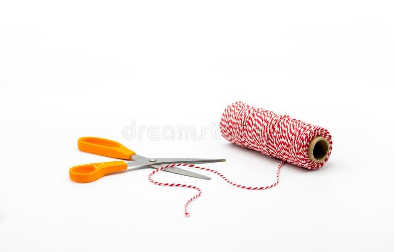 Pomarańczowi nożyce z arkaną na białym tle zdjęcie stock