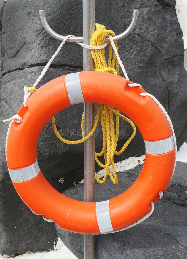 Pomarańczowy lifebelt z żółtą arkaną zdjęcia royalty free