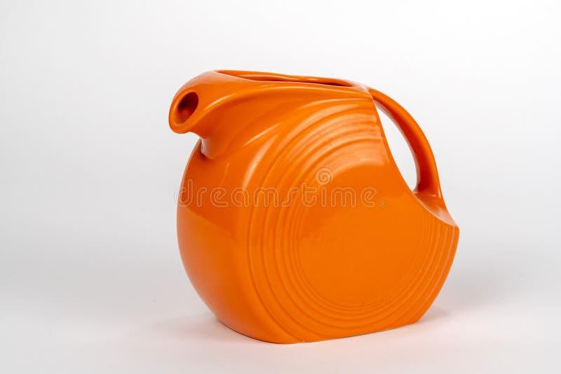 Pomarańczowy miotacz z rękojeścią odizolowywającą zdjęcie stock