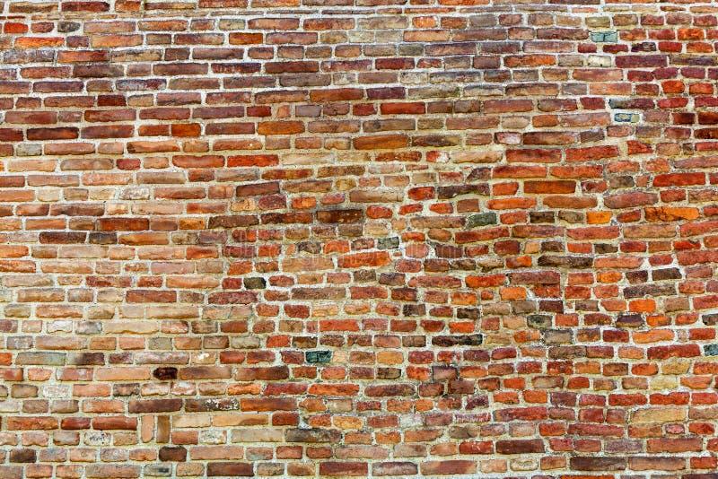 Pomarańczowy stary ściana z cegieł zdjęcie royalty free