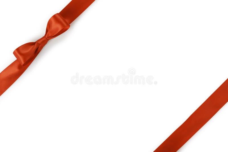 Pomarańczowy tasiemkowy łęku skład odizolowywający na białym tle z cieniem zdjęcia stock