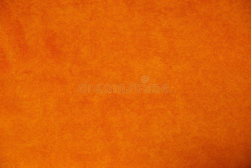 Pomarańczowy zamszowy tło obrazy stock