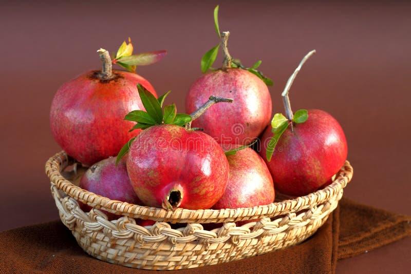 Pomegranate. Fresh pomegranate in wood basket stock photo
