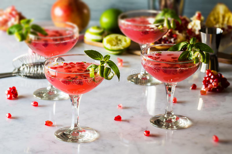 Pomegranate Basil Martini or Gin Smash Cocktail stock images