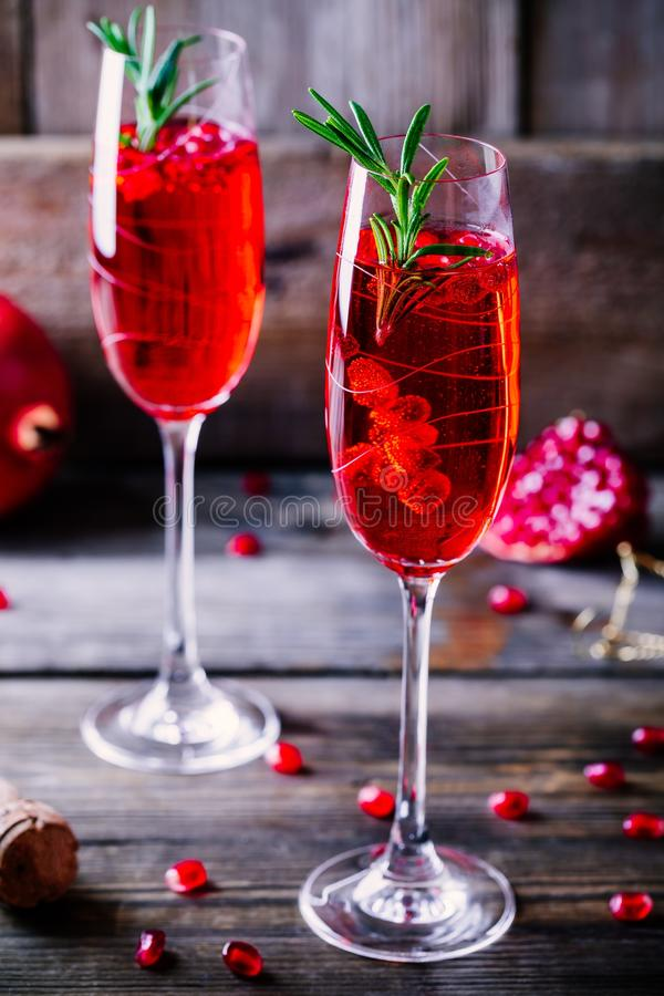 Pomegranate champagne mimosa cocktail with rosemary stock image