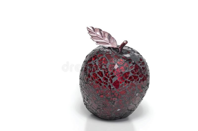 Pomegranate decorative item isolated. Pomegranate decorative item made with red glass pieces isolated royalty free stock photography