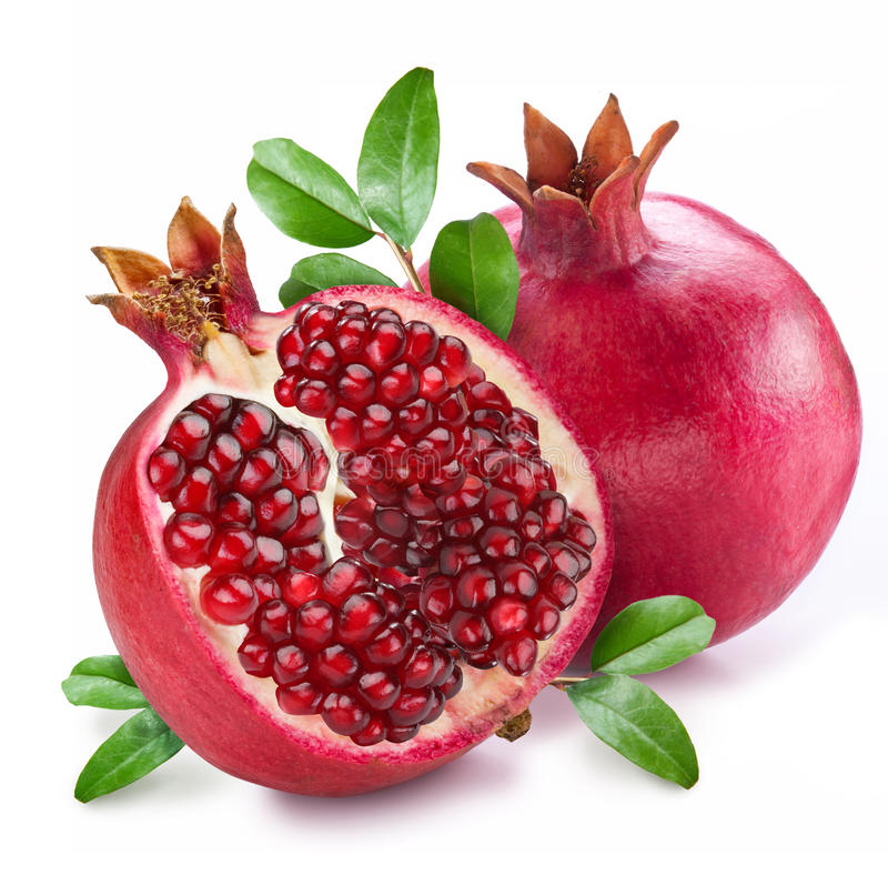 Pomegranate fruit with green leaves on a white background. stock image
